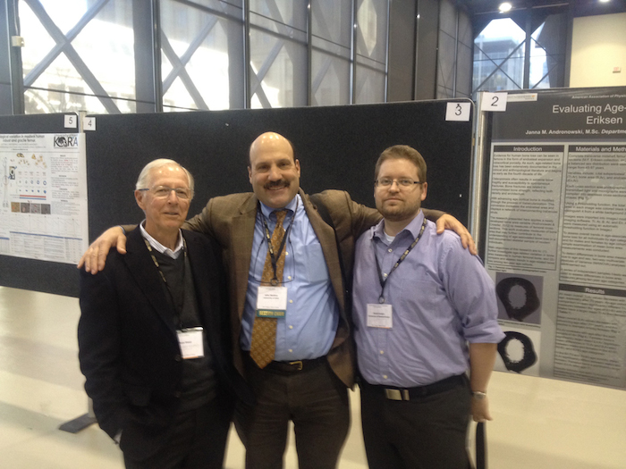 John Skedros with Sam Stout (left) and David Cooper (right) in 2014.
